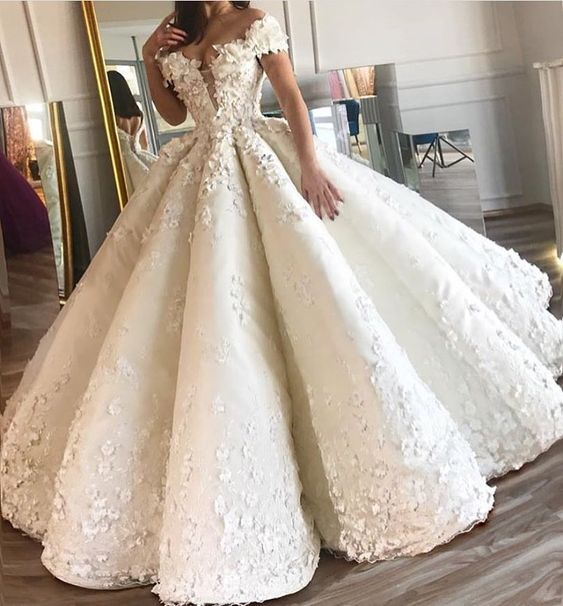 Here is an off the shoulder #weddingdress design with a ball gown skirt.  Get custom #weddingdresses like this for a great price.  Making #replicas of couture designs is also one of our specialties.
