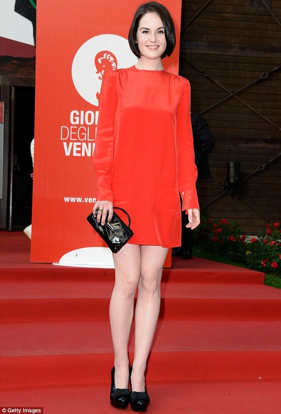 In the red: Michelle Dockery shows off her sleek dark bob as she attends the Miu Miu party at the Venice Film Festival in a striking red dress on Thursday night