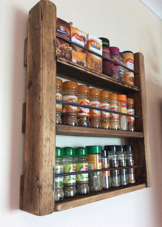 Thank you for visiting my shop! You are currently vieiwing my spice rack, made from reclaimed scaffold board, pallet wood and steel rebar. I do a lot of cooking (with lots of spices, as you can probably tell from the picture) and these took up quite a bit of space in the food cupboard. Aside from this, I like my herbs and spices on display, where I can see them, without having to root around to find the one I need. Because this spice rack is made from reclaimed wood, each piece of wood has a...