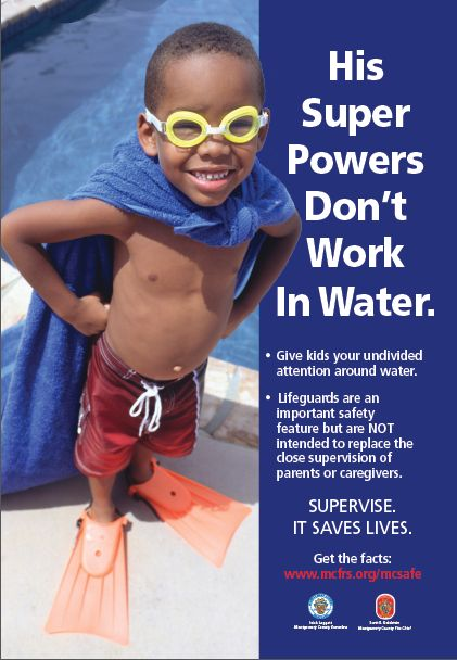 photo of child poolside with cape and goggles on