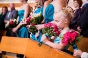 Orchard Photography flower girl in blue dress captured by Orchard Photography | As seen on TodaysBride.com