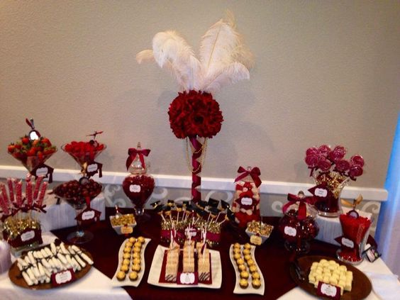 Maroon white and gold graduation candy buffet table