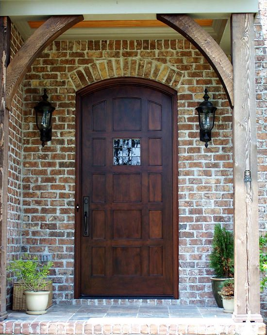 "Pictured is a Country French Segment Top Exterior Wood Entry Door 42"" X 96"" made of  Mahogany installed on a home in Birmingham, Alabama.  This door has 14 Flat Panels and Leaded Restoration Glass.  The Rocky Mountain Bronze G641/E431 hardware adds the finishing touch to this Country French Home.:"