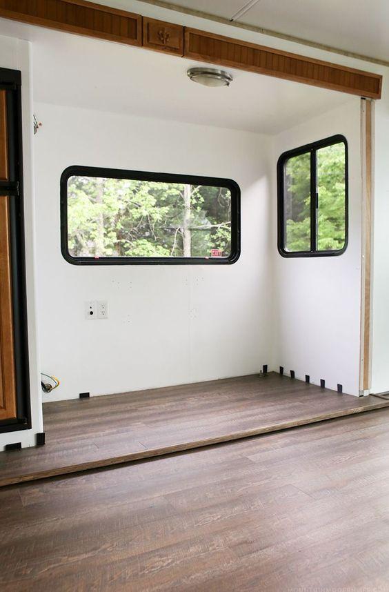 Planning to replace the flooring in your RV or camper? After some trial and error we are sharing some tips to replace the flooring Inside a RV slide out   MountainModernLife.com