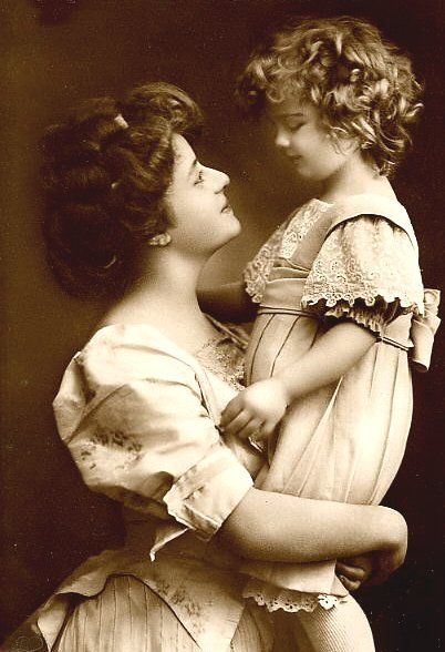I have one room (guest bedroom) that is decorated in this fashion .... Victorian, Mother and Child pictures, Mother and Child figurines, articles of Victorian clothing displayed, Such a sweet room! C: (  Mother and Child - vintage photo, 1900-1919):