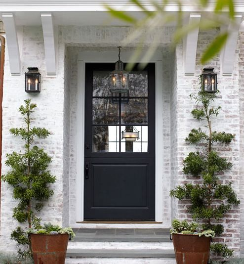 white washed brick, black painted door