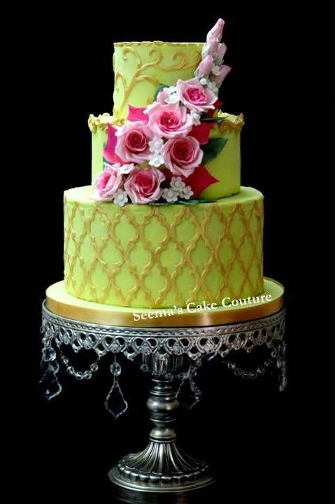 Apple green and gold cake to match the brides outfit for wedding reception