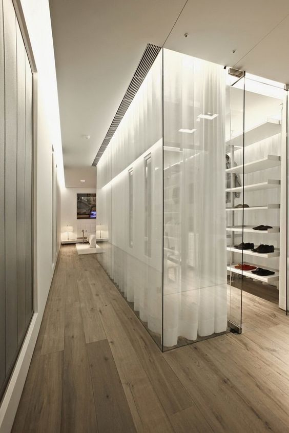 how incredible is this contemporary glass walk-in closet?