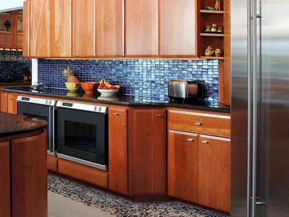 See how blue glass tiles make a dramatic statement in any style kitchen at HGTV.