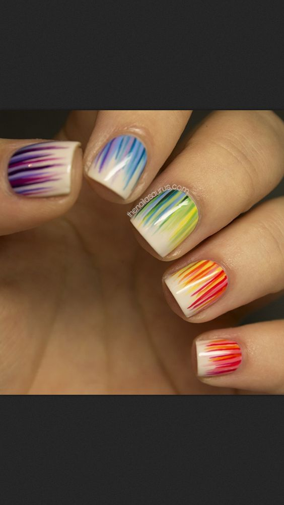 Paint your nails white and take a striper and flick short lines up from your cuticle for this cute nail design!