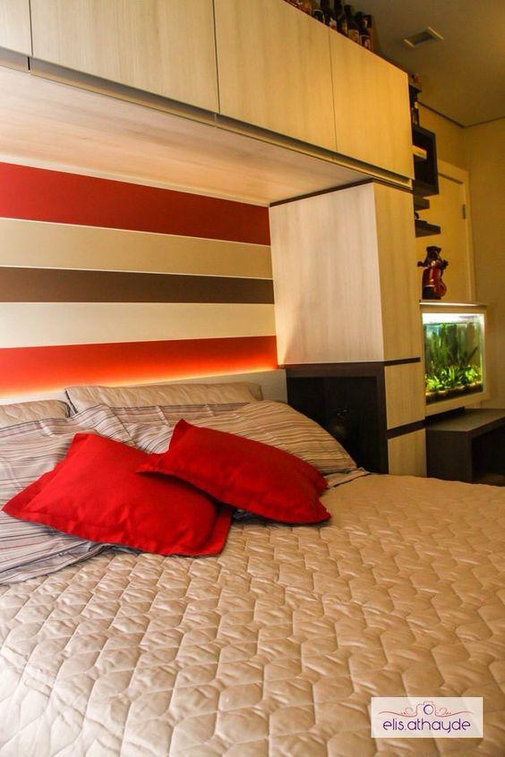 Um estimado aquário foi inserido neste projeto de dormitório, agregado à iluminação, o resultado foi surpreendente! Projeto by Basi Arquitetura.