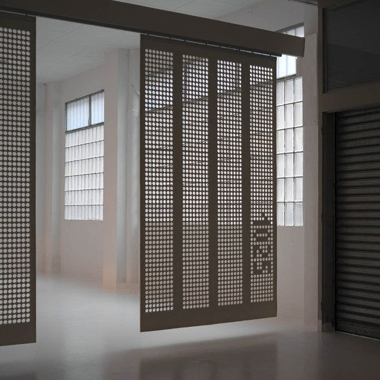 moveable curtain panel walls like the pierced screen and