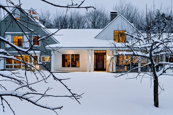 Love the colours - whites to blue greys to warm yellows to black.  farmhouse exterior by Whitten Architects