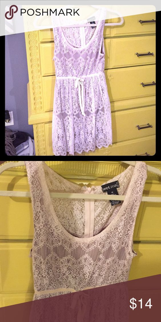 Tan Lace Dress This is a dress I wore to a concert with cowgirl boots! It's super cute and comfortable. It comes with a brown silky slip underneath! Wet Seal Dresses