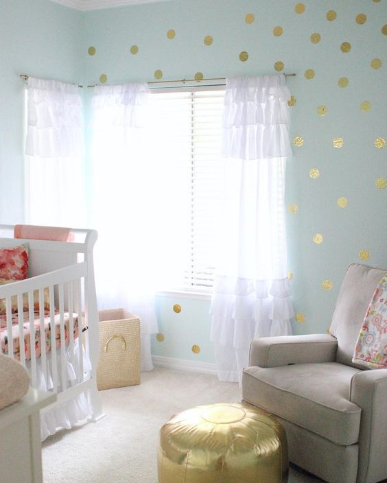 Gold foil polka dots in a glam  nursery