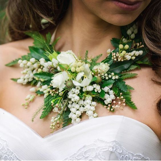 If you don't want to carry a bouquet, you could just wear it around your neck!