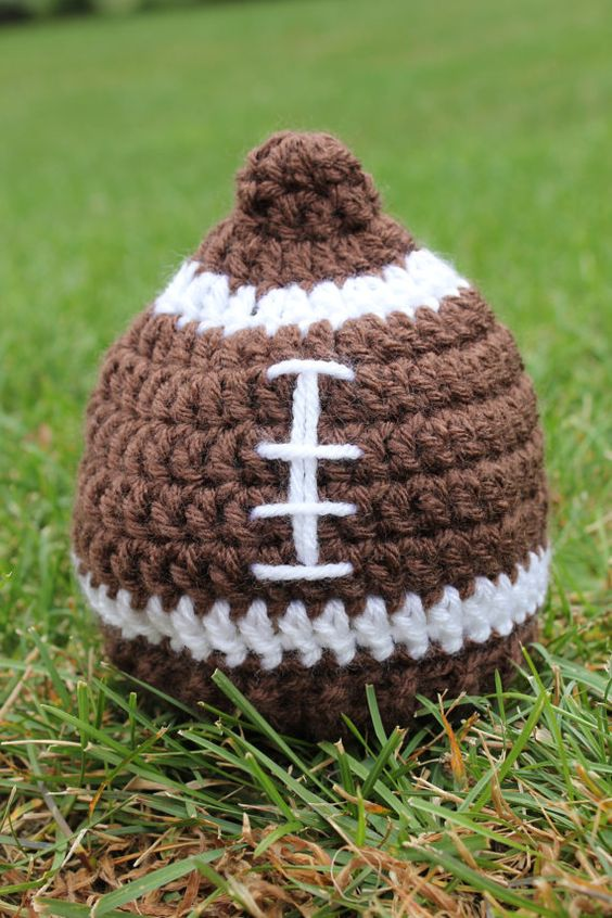 This hat is perfect for everyday wear and photo props! This listing is for a football-shaped, brown colored hat, as shown above, in 0-3 months size.
