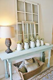 The Farmhouse Porch: Entry Way Refresh.  Simple color sceme, matching arrangements, and rustic/vintage decor