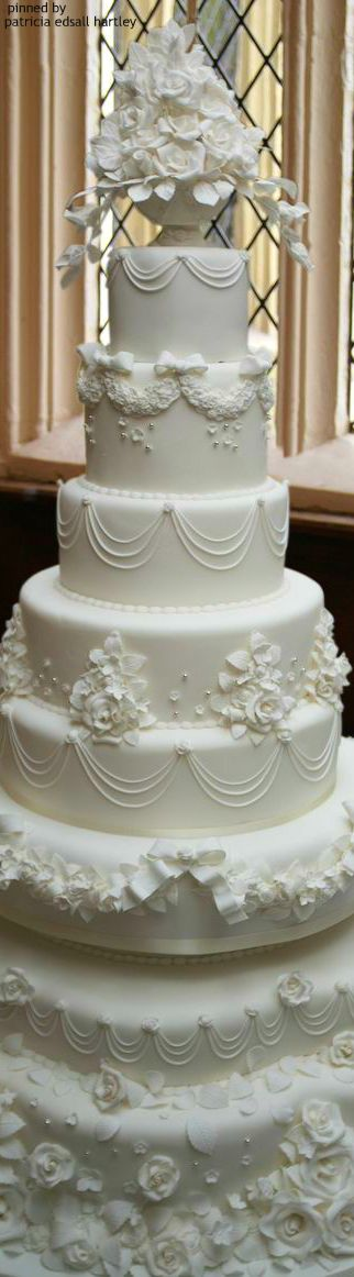 Resplendent, towering wedding cake all in white.                                                                                                                                                      More