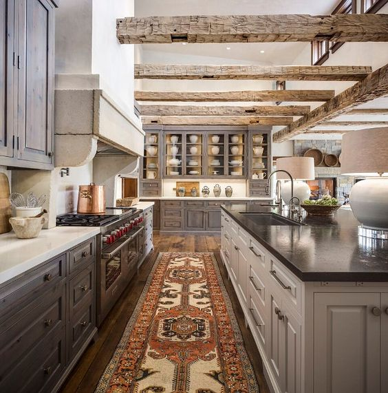 Rustic Kitchen. Rustic kitchen with reclaimed beams, stained rustic cabinets and…