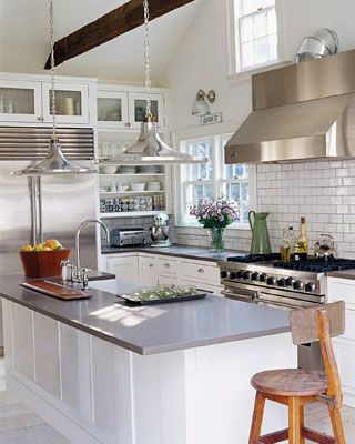 Gray and White kitchen. I like the tile and that crazy interesting nook area in the back