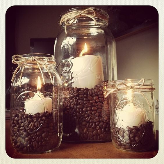 Mason jar candle set - So easy to make! Just buy different sized mason jars, fill with coffee beans and vanilla pillar candles, and tie some rope around the tops for something a little extra. They look great AND your house will smell fantastic!: