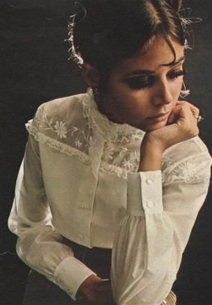 Colleen Corby modelling a white embroidered blouse
