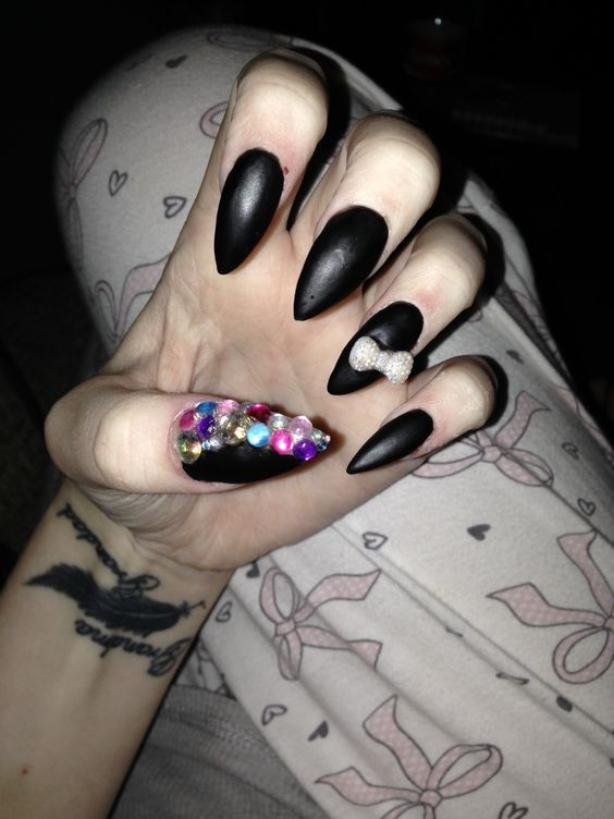 Black stiletto nails with gems and bows