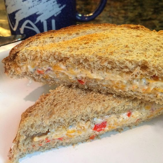 Healthy Pimento Grilled Cheese by theglasser Serves: 1 Ingredients 2 slices of light bread 2 tbsp whipped cream cheese 1 tsp light mayonnaise 1/4c (1 serving) shredded fat free cheddar cheese 1/4-1/2 pimento pepper, finely chopped (use more or less… Continue Reading →
