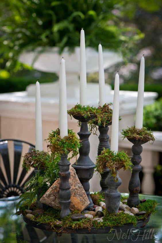 Garden table setting moss and candles centerpieces