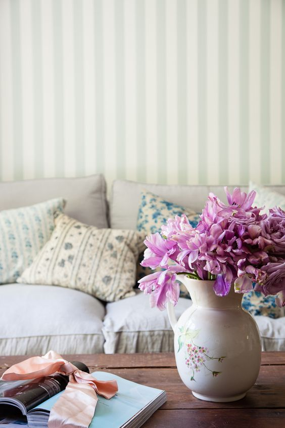 Shades of vintage chenille and linen fabrics made into a symphony of blue pillows