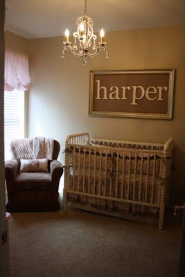 Framed name above crib make it out of cork board and use it..forever. to hang stuff on :)