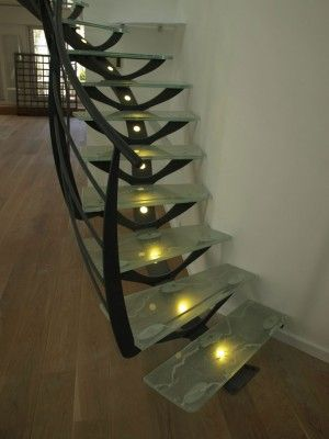 organic steel and glass stair; the central spine has lights in it.