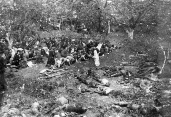 Lithuania, 1941, Jewish women digging their own graves. The women dug their own graves before Einsatzgruppen soldiers shot them. In the foreground lay people who have already been shot. Imagine if this was you. Knowing that in moments, you will be dead. Seeing those that went moments before you. What evil in these nazis by olive