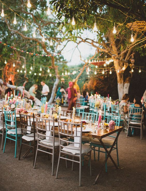 Colorful India Wedding and outdoor wedding reception.  Photography by A Fist Full of Bolts.
