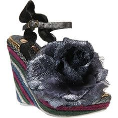 BETTER IN PINK  The Weaver is a wedge heel from Irregular Choice that has an adjustable ankle strap and a floral upper.