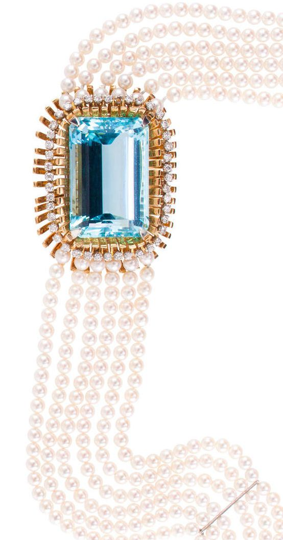 An aquamarine, diamond and cultured pearl necklace designed as a choker, centering a cut-cornered rectangular step-cut aquamarine, within a polished gold spray basket, accented by round brilliant-cut diamonds, completed by six strands of cultured pearls, measuring approximately 3.50 to 3.90mm.; aquamarine weighing approximately 55.00 carats; estimated total diamond weight: 1.00 carat; mounted in eighteen karat gold; length: 15 1/2in.