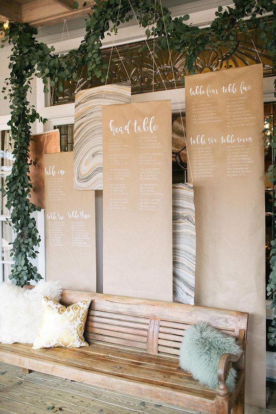 Table assignments hanging among the greenery Photo: Nichols Photographers   Venue & Accommodations: Hoffman Haus   #bridesofaustin #wedding #weddinginspiration #thisandthat