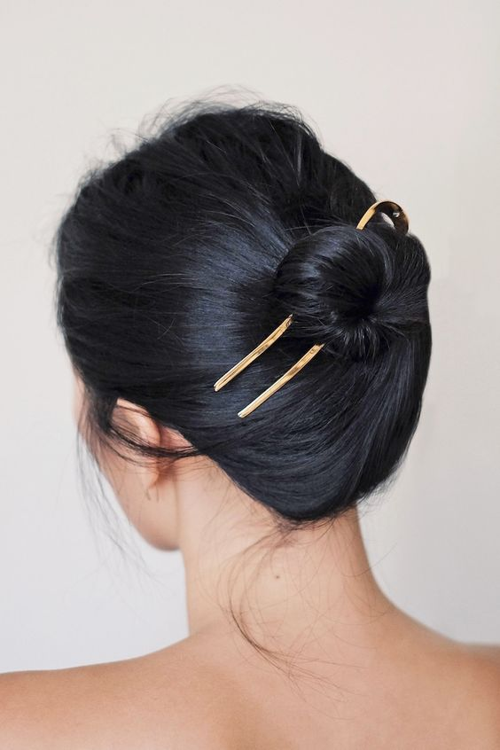 Hair accessories don't always have to make a loud statement. There are plenty of options for the minimalist that are understated while still being able to turn heads. Enter this minimal-cool hair look from Ann Kim of the  LA-based blog Andy Heart.Her sleek bun is brought to the next level with a  simple, yet stunning gold hair pin that we can't wait to get our hands on.