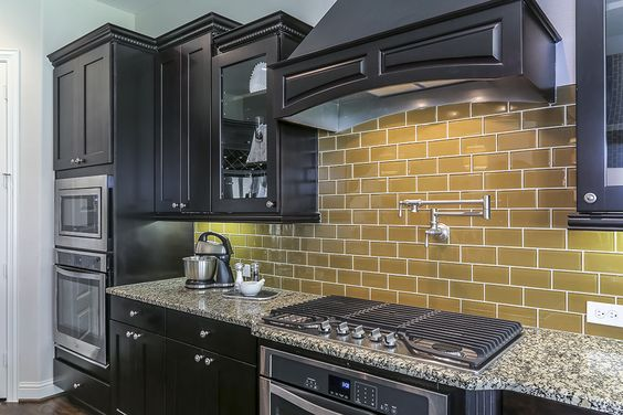 Dark brown cabinets kitchen yellow and brown cabinets on for Brown kitchen cabinets with black appliances