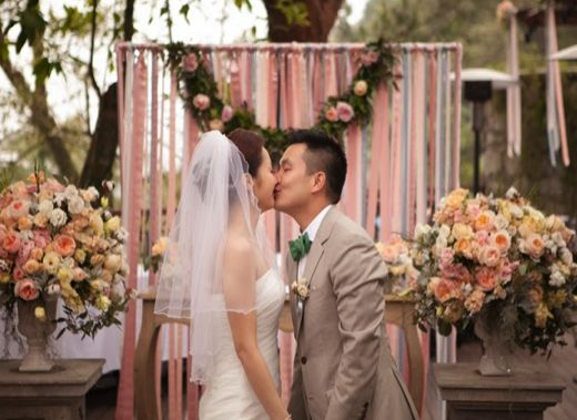 Dream of a simple wedding with draping curtains & pastel coloured bouquets?