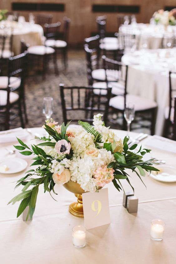 centerpiece with anemones - photo by The Compass Points Here http://ruffledblog.com/ethereal-chapel-wedding