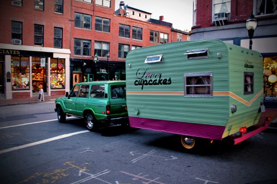 Love when they use vintage trailers for cupcakes!