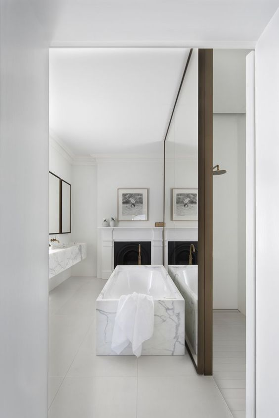 White marble bathroom by Smart Design StudioPhoto by Sharrin Rees