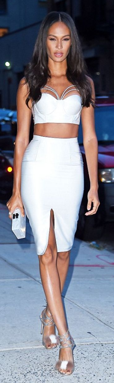 Joan Smalls: Shirt and skirt – Misha Collection  Shoes – Gianvito Rossi  Purse – Edie Parker