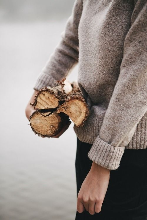 Cozy sweater and wood for the fire.