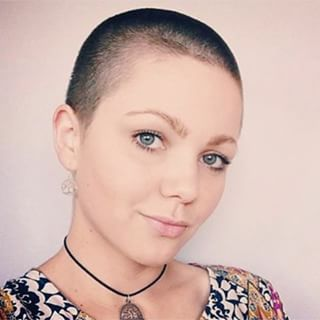 This cutie, who radiates sweetness. | 21 Gorgeous Women Whose Shaved Heads Will Give You Life: