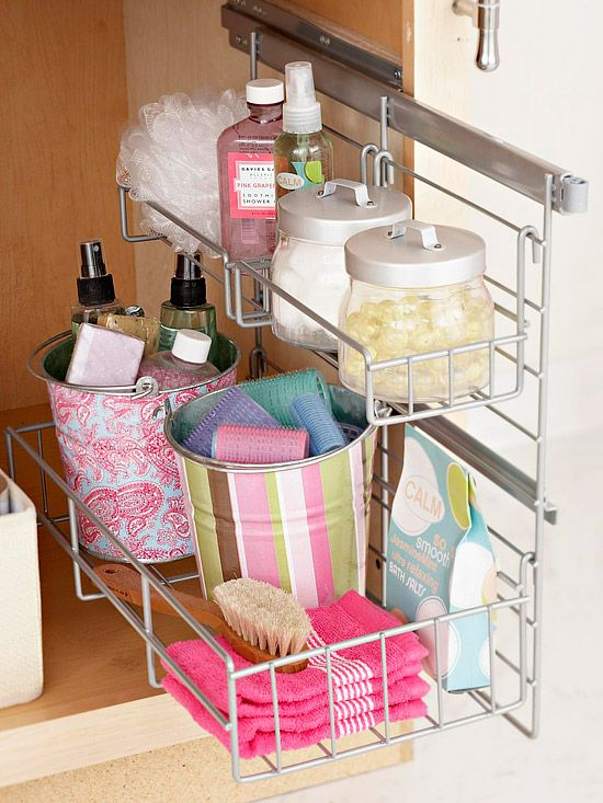 Pull-out shelves add extra storage in cramped bathroom cabinets. Find 30 ways to store more in your bath: http://www.bhg.com/bathroom/storage/storage-solutions/store-more-in-your-bathroom/?socsrc=bhgpin060512