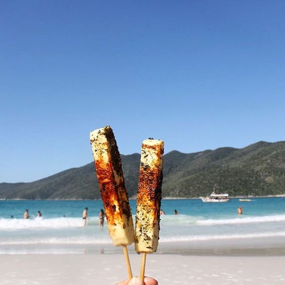 Grilled queijo coalho (best cheese ever) + oregano on a stick. Típicas beach food in Rio