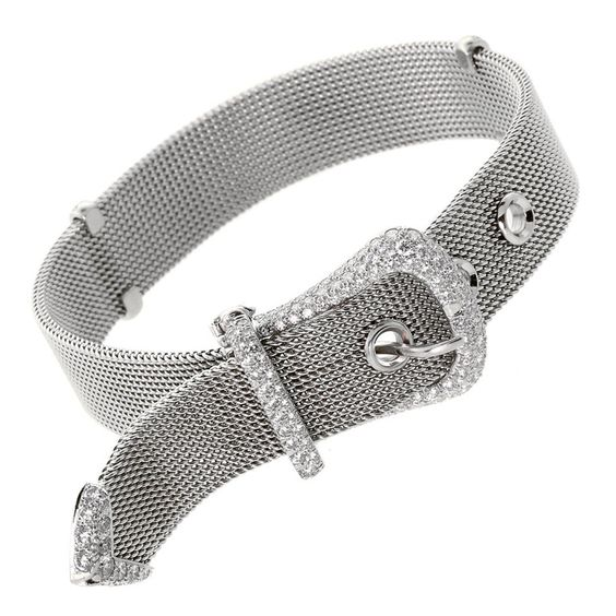 "Tiffany & Co. Diamond Platinum Buckle Bracelet. A fine Tiffany & Co. Platinum Buckle Diamond Bracelet. The bracelet measures .57"" wide, and can we worn at 6"", 6.5"" or 7 inches in length. It is adorned with appx 3ct of Natural Round Brilliant Diamonds that are F Color VS Clarity. The buckle measures 20.5mm Wide by 24.5mm long. Hallmarked Tiffany & Co, PT950, 1997"